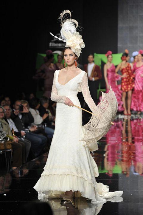 Event, Dress, Fashion show, Runway, Fashion model, Gown, Costume design, Fashion, Model, Public event,
