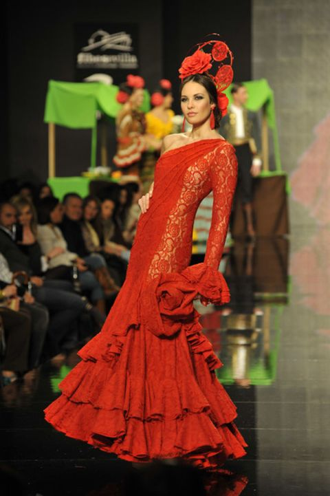 Red, Headpiece, Headgear, Hair accessory, Fashion, Gown, Costume design, Lipstick, Toy, Haute couture,
