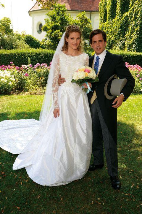 Clothing, Dress, Trousers, Coat, Petal, Bridal clothing, Wedding dress, Photograph, Bride, Outerwear,