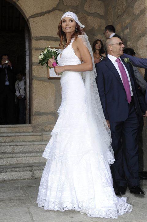 Trousers, Dress, Bridal clothing, Shoulder, Shirt, Photograph, Shoe, Outerwear, Coat, Gown,