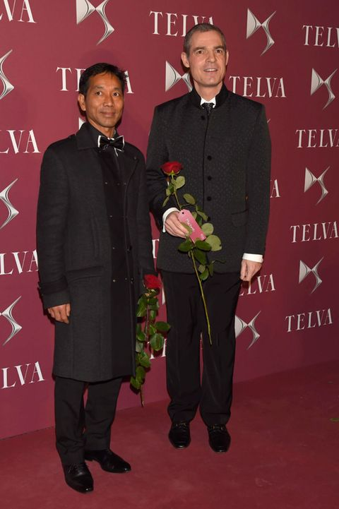 Red, Formal wear, Suit trousers, Blazer, Bouquet, Rose, Artificial flower, Carpet, Cut flowers, Tuxedo,