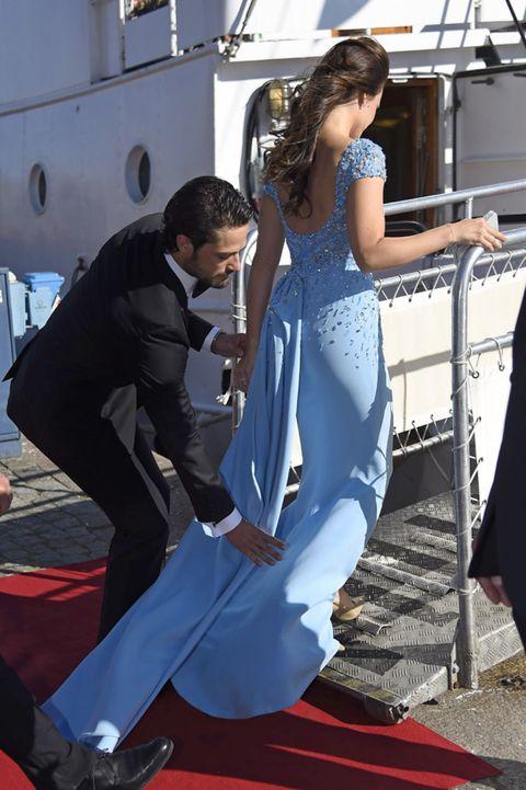 Shoe, Formal wear, Dress, Flooring, Suit, Carpet, One-piece garment, Gown, Waist, Fashion design,