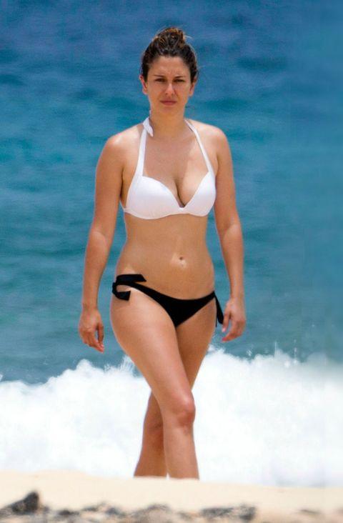 Clothing, Brassiere, Skin, Shoulder, Human leg, Photograph, Joint, Standing, Chest, Swimsuit bottom,