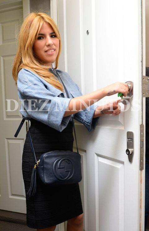 Shoulder, Standing, Bag, Fixture, Door, Luggage and bags, Electric blue, Blond, Home door, Major appliance,