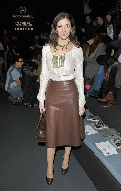 Clothing, Footwear, Leg, Brown, Human body, Shoulder, Joint, Outerwear, Fashion show, Style,