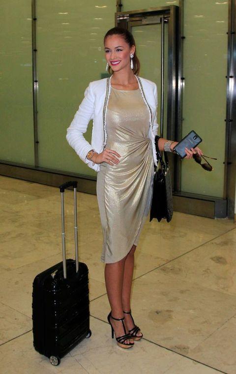 Shoulder, Dress, Joint, Formal wear, Fashion accessory, One-piece garment, Waist, Fashion, High heels, Jewellery,