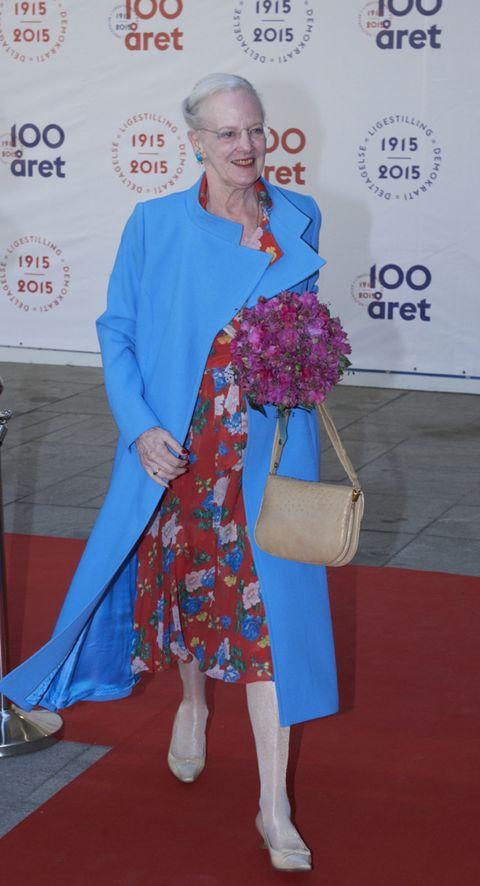 Flooring, Electric blue, Carpet, Fashion, Logo, Cobalt blue, Majorelle blue, Artificial flower, Red carpet, Bouquet,