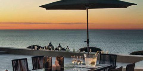 Water, Table, Furniture, Chair, Outdoor table, Ocean, Horizon, Sea, Outdoor furniture, Dusk,