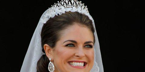Clothing, Bridal clothing, Hairstyle, Skin, Sleeve, Bridal accessory, Forehead, Shoulder, Eyebrow, Wedding dress,