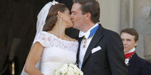 Clothing, Dress, Coat, Trousers, Bridal veil, Bridal clothing, Photograph, Outerwear, Petal, Formal wear,