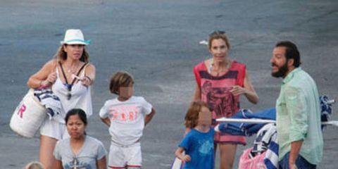 Clothing, Hair, Leg, Child, Shorts, Luggage and bags, Travel, Toddler, Street fashion, Pedestrian,
