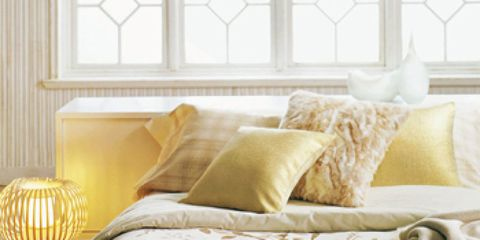 Room, Interior design, Yellow, Property, Bedding, Textile, Wall, Furniture, Linens, Bedroom,
