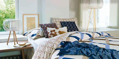 Blue, Room, Interior design, Textile, Furniture, Linens, Floor, Home, Bedding, Clothes hanger,