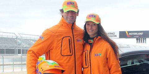Cap, Smile, Sleeve, Jacket, Motorcycle helmet, Headgear, Orange, Jersey, Uniform, Baseball cap,