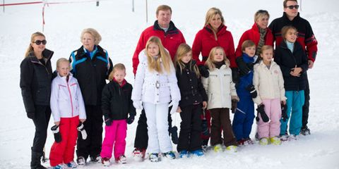 Footwear, Winter, Jacket, Trousers, Recreation, Social group, Outerwear, Playing in the snow, Snow, Winter sport,