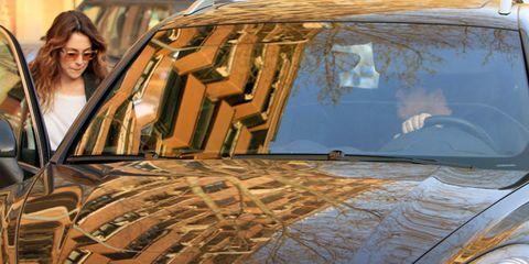 Glasses, Automotive exterior, Hood, Grille, Reflection, Automotive window part, Brown hair, Classic car, Sport utility vehicle, Kit car,