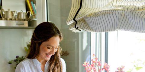 Room, Textile, Interior design, Window covering, Interior design, Curtain, Bouquet, Shelf, Window valance, Bottle,