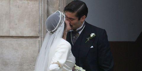 Clothing, Coat, Bridal veil, Suit, Photograph, Outerwear, Formal wear, Bridal clothing, Wedding dress, Bridal accessory,