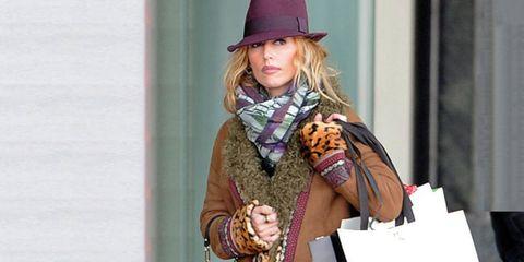 Clothing, Hat, Hand, Fashion accessory, Street fashion, Fashion, Stole, Sun hat, Glove, Scarf,