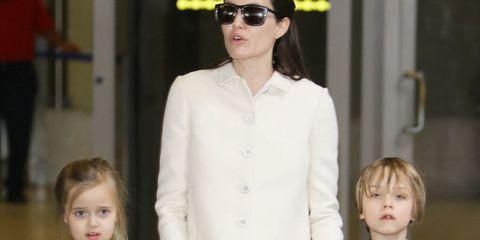 Eyewear, Sleeve, Human body, Sunglasses, Standing, Child, Style, Fashion, Street fashion, Goggles,