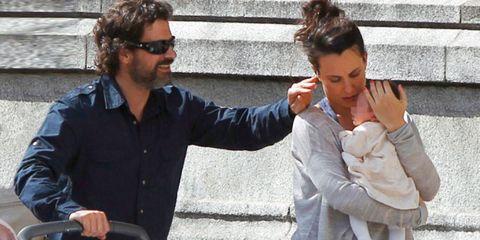 Arm, Hand, Sunglasses, Dress shirt, Gesture, Beard, Conversation, Facial hair, Sweater, Stairs,