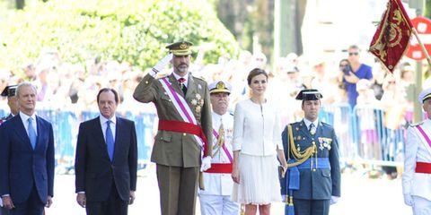 Hat, Military person, Military uniform, Standing, Suit trousers, Uniform, Cap, Formal wear, Headgear, Suit,