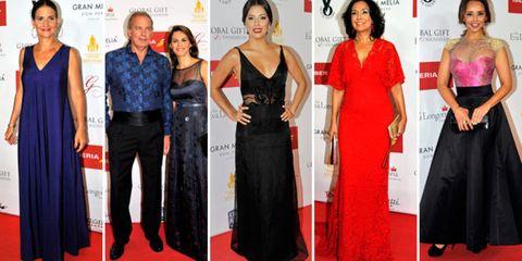 Clothing, Dress, Flooring, Red, Formal wear, Style, Waist, Carpet, Fashion, One-piece garment,