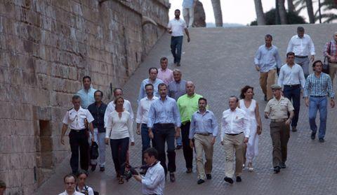 People, Social group, Mammal, Community, Tourism, Adaptation, Temple, Sharing, Brick, Stone wall,