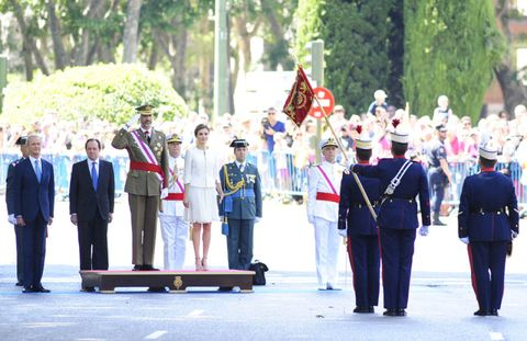 Standing, Uniform, Flag, Military person, Parade, Bench, Military organization, Crew, Ceremony, Military rank,