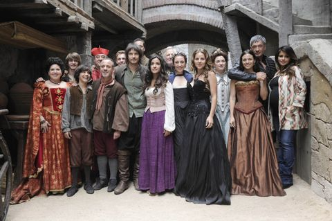 People, Social group, Dress, Formal wear, Costume, Fashion, Temple, Victorian fashion, Costume design, Gown,