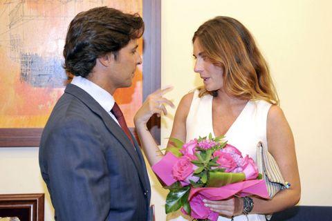 Coat, Bouquet, Outerwear, Suit, Formal wear, Happy, Petal, Purple, Interaction, Dress,