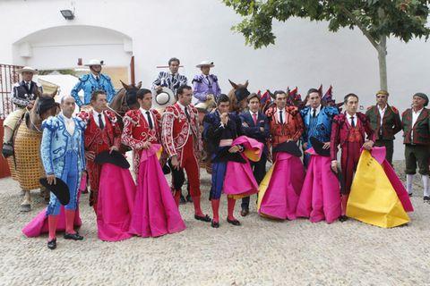 Magenta, Tradition, Headgear, Costume, Costume accessory, Costume design, Boot, Festival, Costume hat,