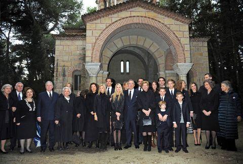 Footwear, Social group, Formal wear, Arch, Suit trousers,