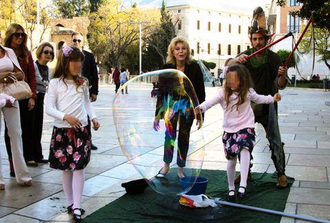 Footwear, Leg, Public space, Human settlement, Play, Toy, Liquid bubble, Handbag,