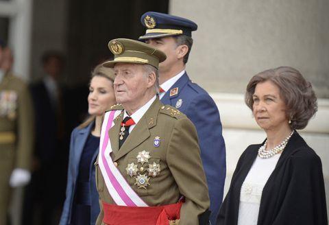 Cap, Collar, Uniform, Military person, Interaction, Jewellery, Military uniform, Blazer, Badge, Peaked cap,