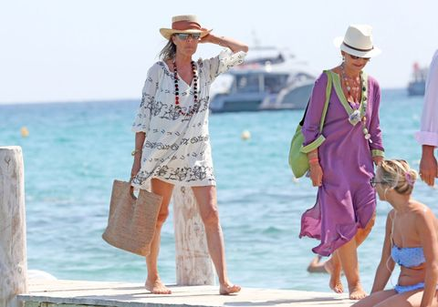 Hat, Tourism, People on beach, Summer, Bag, Leisure, Sun hat, Dress, People in nature, Fashion accessory,