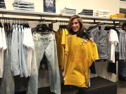 Retail, Textile, Room, Clothes hanger, Denim, Fashion, Outlet store, Boutique, Fashion design, Service,