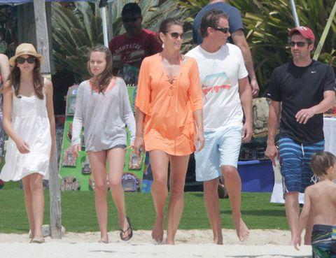 Eyewear, Leg, Human body, Sunglasses, Hat, Leisure, Summer, Shorts, Dress, Fashion accessory,