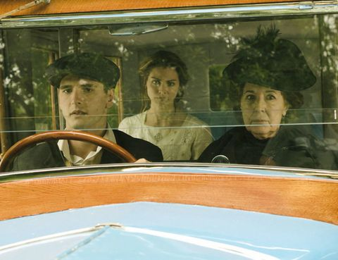 Motor vehicle, Eye, Glass, Headgear, Windshield, Automotive window part, Vehicle door, Vintage clothing, Classic, Reflection,