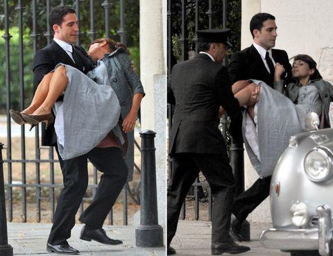 Footwear, Leg, Trousers, Shoe, Outerwear, Coat, Formal wear, Suit, Style, Sitting,
