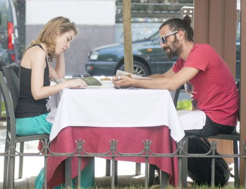 Human body, Table, Furniture, Chair, Tablecloth, Outdoor furniture, Outdoor table, Sitting, Auto part, Linens,