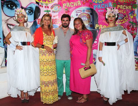 Hat, Flooring, Headgear, Tradition, Costume accessory, Magenta, Sun hat, Costume, Hair accessory, One-piece garment,