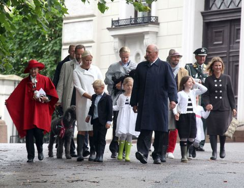 Footwear, People, Winter, Family, Boot, Tradition, Ceremony, Sun hat, Family reunion, Walking,