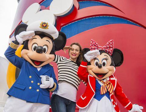 Smile, Happy, Mascot, Costume accessory, Animated cartoon, Cartoon, Walt disney world, Animation, Celebrating, Costume hat,