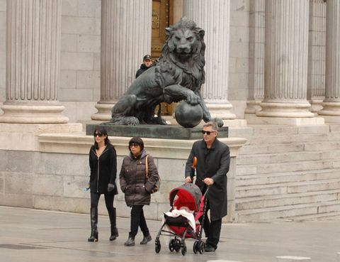 Product, Big cats, Sculpture, Felidae, Standing, Baby carriage, Jacket, Temple, Carnivore, Baby Products,