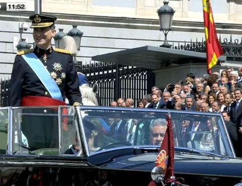 People, Flag, Event, Car, Uniform, Crowd, Cap, Parade, Luxury vehicle, Public event,