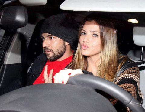 Nose, Mouth, Eye, Facial hair, Cap, Beard, Interaction, Moustache, Black hair, Vehicle door,