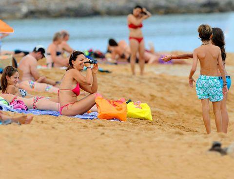 Clothing, Fun, Swimwear, People on beach, Beach, Summer, Brassiere, Leisure, Sand, Bikini,