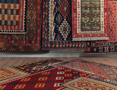 Red, Textile, Rug, Interior design, Carpet, Pattern, Flooring, Maroon, Motif, Visual arts,