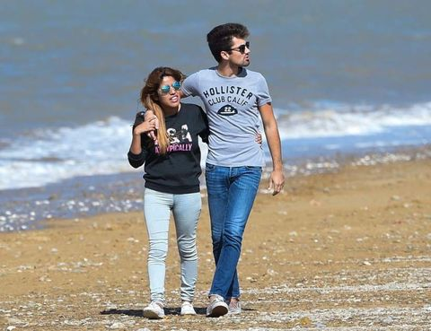 Trousers, Jeans, Shirt, People on beach, Denim, Shore, Coastal and oceanic landforms, Tourism, Leisure, Coast,